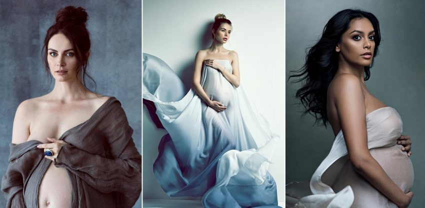 Trzy kobiety z sesji ciążowej. Mają na sobie zwiewne sukienki i pokazują brzuchy